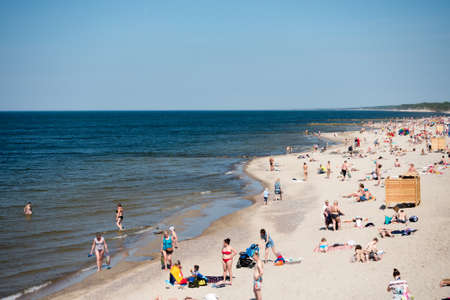 baltic people: Zelenogradsk, Russia - May 23, 2016: People relax at city beach on Baltic Sea coast at sunny day Editorial