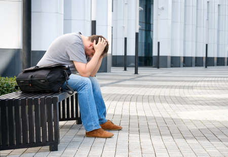 Sad middle age man portrait outdoors Stock Photo