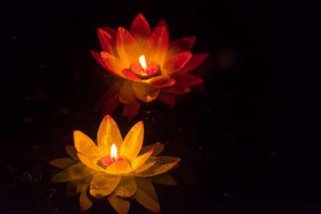 lotus lantern: Floating paper lanterns on the water at night Stock Photo