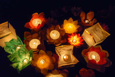 fire flower: Floating paper lanterns on the water at night Stock Photo