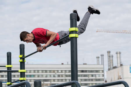 Moscow, Russia - September 10, 2016: Young man practice street workout on open competition dedicated to City Day