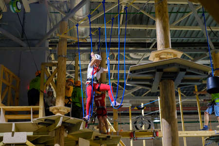 clambering: Moscow, Russia - September 10, 2016: Children age 6-12 attend indoor adventure climbing park at day time Editorial