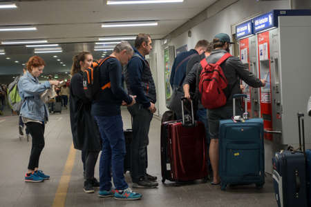 maschine: Berlin, Germany - September 19, 2016: People buying subway tickets in vending maschine at evening Editorial