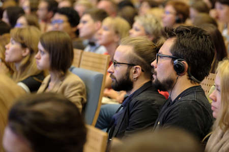 listeners: Moscow, Russia - September 2, 2016: People attend Digital Marketing Conference in Russia Today information agency big hall at day time. Editorial