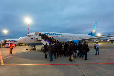 Moscow, Russia - October 5. 2016: Passengers boarding on the aircraft of low cost airline company Pobeda Editorial