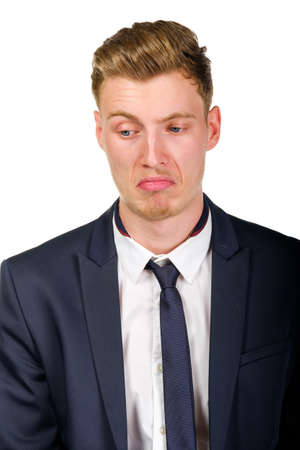 is disgusted: Disgusted young business man wearing suit isolated on white portrait