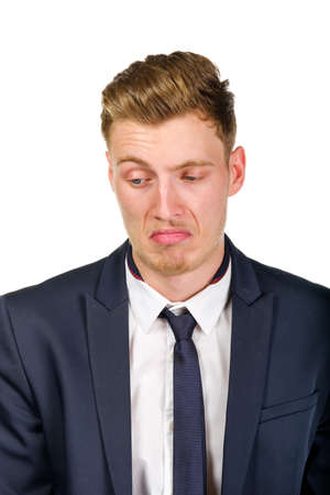 disgusted: Disgusted young business man wearing suit isolated on white portrait