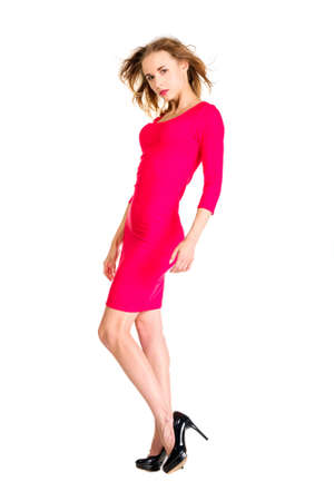 seductive women: Young slim pretty woman dressing red dress posing isolated on white