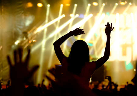 Fans cheering at open-air live concert. Image not in focus Stock Photo