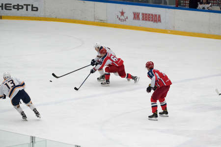 Chekhov, Russia - January 7, 2016: Hockey match between the teams Zvezda (Chekhov) and Orsk (Southern Urals) in Vityaz Ice Palace. Zvezda wins 4:2 Editorial