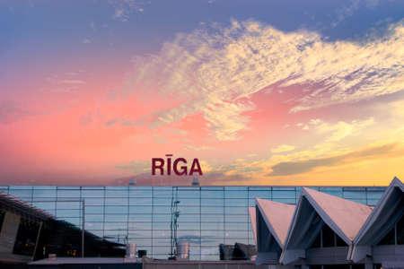 Riga international airport building exterior at sunrise Stock Photo