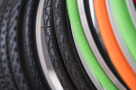 Bicycle tires of different colors and tread patterns