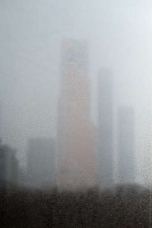 Skyscrapers outside the window, its raining