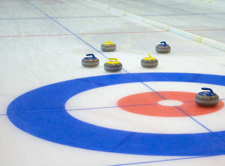Curling stones equipment on the ice
