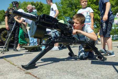 Baltijsk, Russia - July 30, 2017: Unidentified children age 5-10 years try real weapons during the parade of the Russian Navy Editorial