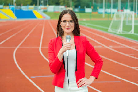 showreel: Young girl TV reporter is broadcasting from stadium