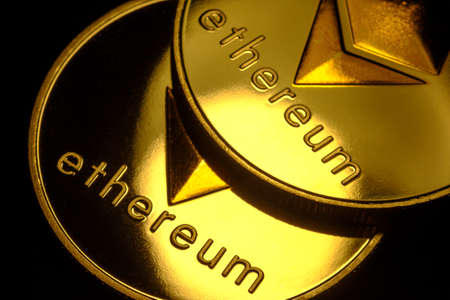 Ethereum macro symbol sign close-up golden coins Zdjęcie Seryjne
