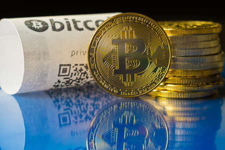 Bitcoin golden coins and paper receipt macro Stock Photo