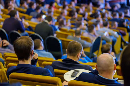 People attend business conference in the congress hall
