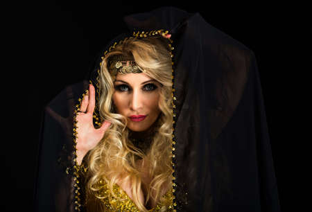 Woman fortune teller portrait on black