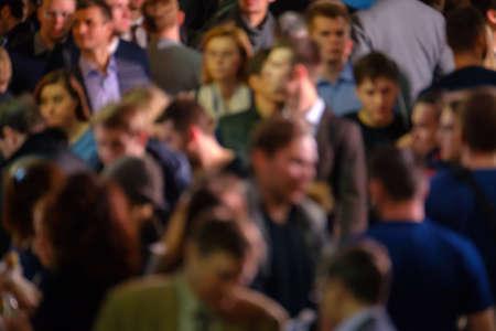 Crowd of walking people walking indoors. Overpopulation concept