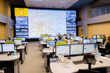 Moscow, Russia - February 9, 2018: Operators work in road traffic control center Stock Photo - 104749958