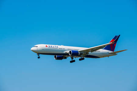Zurich, Switzerland - July 19, 2018: Delta airlines airplane preparing for landing in the blue sky at day time in international airport