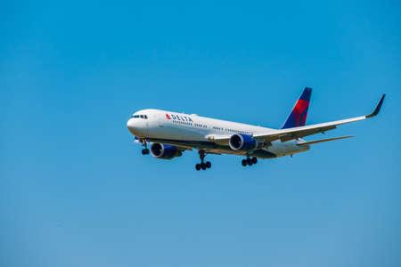 Zurich, Switzerland - July 19, 2018: Delta airlines airplane preparing for landing at day time in Zurich international airport