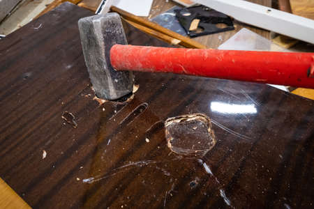 Sledgehammer destroys furniture at apartment close-up
