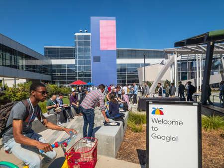 Mountain View, USA - September 25, 2018: Employees working outdoors at Googleplex headquarters main office 報道画像