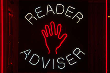 Palm reader adviser neon sign 免版税图像