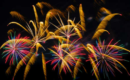Colorful fireworks in night sky background