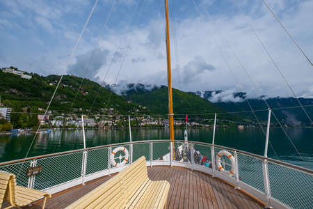 Tourist ship sails along the Lake Geneva to the Chillon Castle.