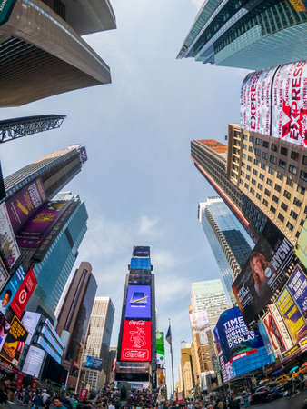 New York, USA - September 6, 2018: Famous attraction place Time Square day time bottom view to scyscrapers
