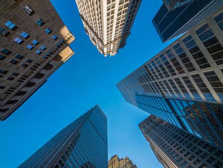 New York skyscrapers bottom view blue sky