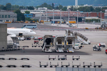 Zurich, Switzerland - July 19, 2018: Zurich airport panoramic landscape at day time, ladders, luggage trolleys and other airport special machines