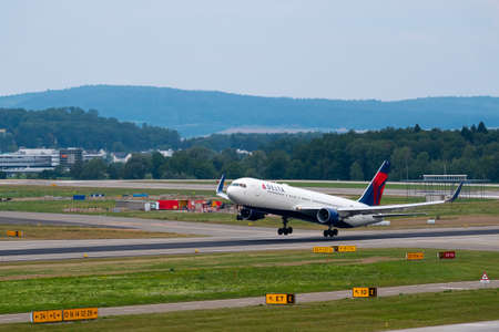 Zurich, Switzerland - July 19, 2018: Delta airlines airplane taking off at day time in international airport Editorial