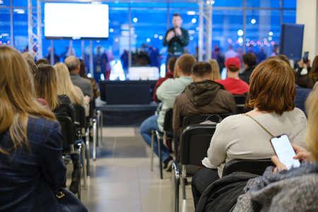 Audience listens lecturer at workshop conference hall