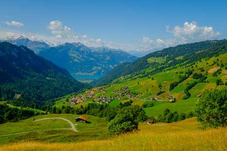 Summer time countryside panoramic landscape in Switzerland near Habkern village