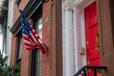 National American flag on building entrance in Manhattan downtown