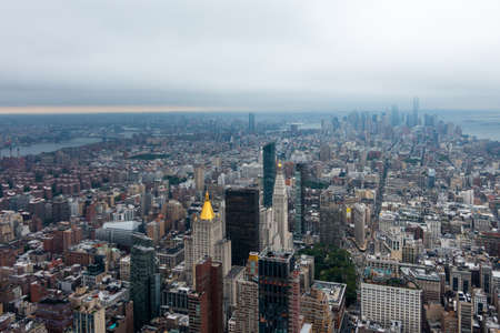 Aerial view of Manhattan skyscrapers at cloudy day time