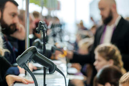 Business forum visitors register at check point Foto de archivo