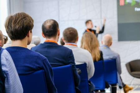 Audience listens lecturer at workshop in conference hall Standard-Bild