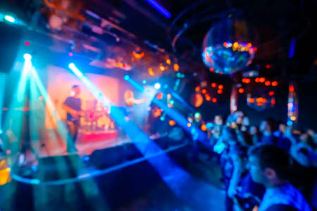 Music band performing live at night club, blurred