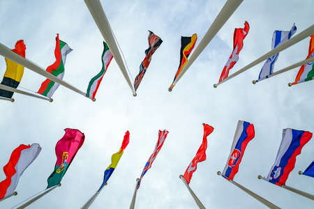 Flags of different countries on flagpoles