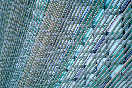 Textured background of metal bars on building Stockfoto