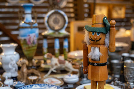 Wooden doll on counter with assorted souvenirs Stockfoto