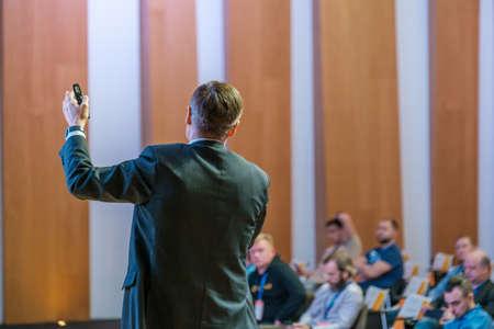 Male presenter speaks to audiences at seminar Stockfoto