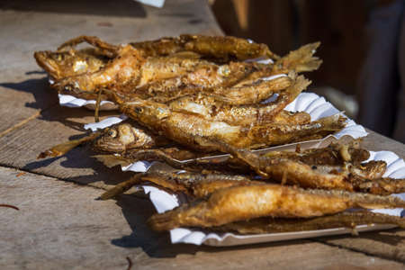 Fried fish on paper plates
