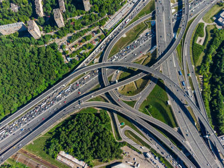Busy multilevel junction in summer in outskirts